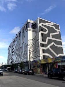 Outside view of WeWork's Wynood Parking Garage and shared work-place.
